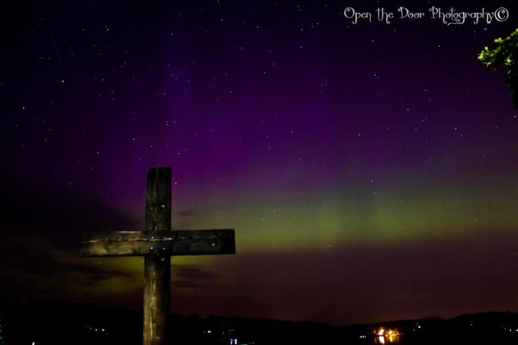 camp cross in northern lights